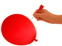 Balloon to go bang, pop - business metaphor. Concept. Hand with dart about to burst someone's bubble royalty free stock photography