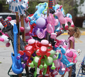 Balloon toys for sale during a parade in small town America Royalty Free Stock Images