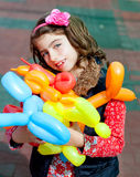 Balloon twisting art children happy. Girl after workshop with many shapes Stock Photography