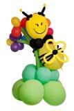 Balloon un'ape su un fiore Immagini Stock Libere da Diritti