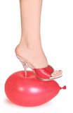 Balloon under spike heel Stock Photos