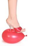 Balloon under spike heel. Red balloon under spike heel Stock Photos