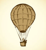Balloon. Vector drawing. Big old airy montgolfier with people in gondola soar up on sail in cloud  on white background. Outline ink hand drawn icon sketch in Royalty Free Stock Images