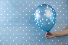 Balloon with white points. On blue background Stock Images