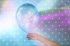 Balloon with white points. On blue background Stock Photo