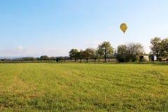 Balloon. Yellow balloon on a clear summer sky Stock Photo