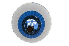 Balloone in the air. A balloon in the air. Bottom view of the basket Stock Image