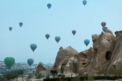 Ballooning. Hot Air Balloons Flying In Sky Above Rock With Caves. Ballooning. Hot Air Balloons Flying In Sky Above Rocks With Caves At Cappadocia. High stock image