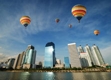 Ballooning over the city Stock Images