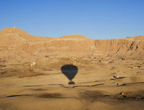 Ballooning over Hatshepsut temple. Shadow of a hot air balloon over Hatshepsut temple in Luxor Stock Images