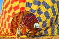 Ballooning. Preparing hot air balloons for take off Royalty Free Stock Images
