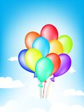 Balloons. Bright multicolored balloons in the blue sky Stock Images