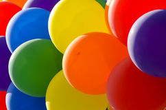 Balloons. A colourful arrangement of helium balloons filling the frame Royalty Free Stock Images