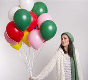 Woman Carrying Colorful Helium Balloon Bouquet Stock Images
