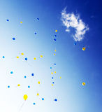 Balloons. In the sky against a background of clouds Royalty Free Stock Photo