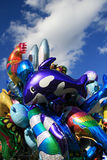 Balloons. Many multicolor balloons in a grope and the blue sky with clouds as a background Royalty Free Stock Photography