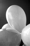Balloons. Black and white balloons against black background Stock Photos