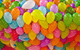 Balloons. Coloured birthday balloons in net Royalty Free Stock Photography