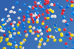 Balloons. Many-coloured balloons flying in blue sky stock photos