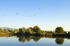 Balloons Above a Quiet Pond Stock Images