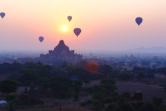 Balloons across the Bagan in sunrise Stock Image