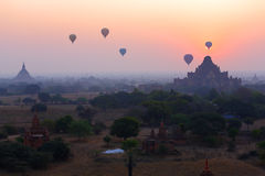 Balloons across the Bagan in sunrise Stock Photography