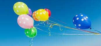 Balloons against the blue sky Stock Photos