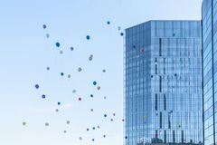 Balloons in the air and city buildings. Shot in Suzhou, China. Blue background royalty free stock photography