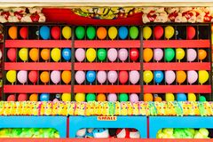 Balloons And Prizes At A Dart Throwing Game Booth At A Carnival, Fair, Or Amusement Park Royalty Free Stock Photos