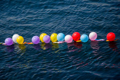 Balloons as targets on water. Balloons in shooting range as targets on water Royalty Free Stock Photos