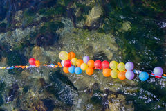 Balloons as targets on water. Balloons in shooting range as targets on water Royalty Free Stock Image