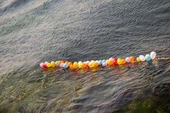 Balloons as targets on water. Balloons in shooting range as targets on water Royalty Free Stock Photography