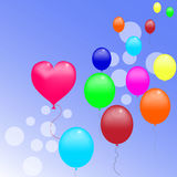 Balloons. Balloon in the form of hearts and other colored balloons fly in the blue sky Stock Image