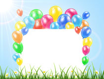 Balloons and banner on a grass Stock Photography