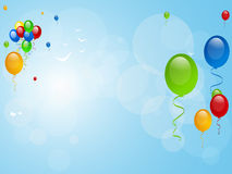 Balloons on a blue background Stock Image