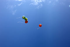 Balloons on blue sky Stock Image
