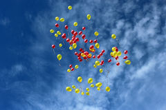 Balloons in blue sky Stock Images