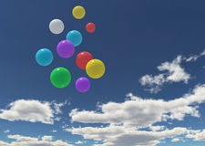 Balloons in the blue sky Stock Photos