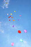 Balloons in the blue sky Royalty Free Stock Photos