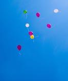 Balloons on the blue sky Stock Photos