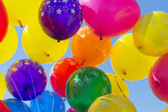 Balloons on blue sky Stock Photos