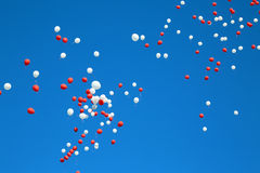 Balloons. In the blue sky flying away Royalty Free Stock Image