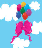 Balloons with a bow in clouds. Stock Image