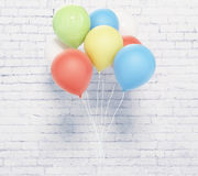 Balloons on brick wall Royalty Free Stock Photos