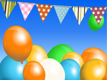 Balloons and bunting over blue sky Royalty Free Stock Photo
