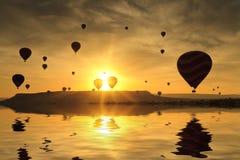 Balloons in Cappadocia at dawn sky Stock Photos