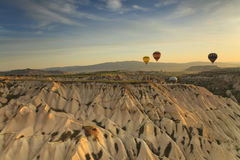 Balloons in Cappadocia over the hills Royalty Free Stock Image