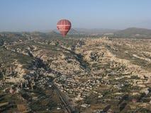 Balloons Cappadocia Turkey. A hot air balloon floating over goreme exotic formations. Cappadocia, Turkey Stock Image