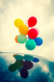 Balloons On Car Roof Stock Photos