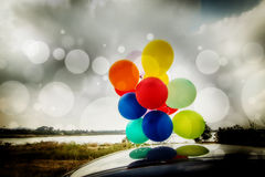 Balloons On Car Roof Royalty Free Stock Photos